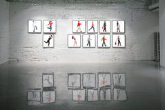 Frames with walking people on white brick wall Stock Image
