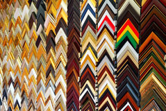 Frames on the wall. A collect of frames on the wall make a beautiful scence.The wooden triangle comes from picture frames stock photo