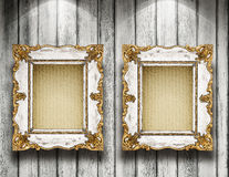 Frames on the wall. Two antique frame on wooden gallery wall Royalty Free Stock Photos