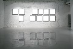 Frames on white brick wall Royalty Free Stock Photography