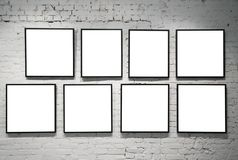 Frames on white brick wall Stock Photography