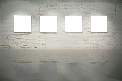 Frames on white brick wall Royalty Free Stock Photo