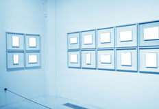 Frames on white wall in art museum. Frames on white wall in museum stock image