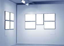 Frames on white wall in art museum. Frames on white wall in  museum Royalty Free Stock Photo