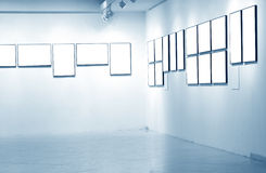 Frames on white wall in art museum. Frames on white wall in museum royalty free stock photos