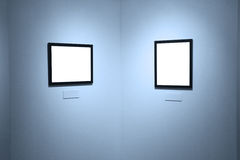 Frames on white wall in art museum. Frames on white wall in museum royalty free stock photography