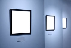 Frames on white wall in art museum Royalty Free Stock Photos