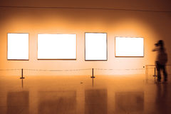 Frames on white wall in art museum Stock Images
