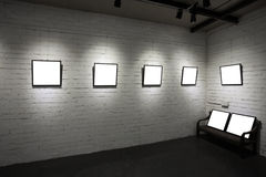 Frames on white wall in art museum Stock Photos