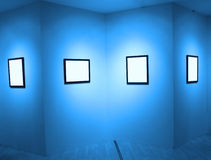 Frames on white wall in  museum Royalty Free Stock Image