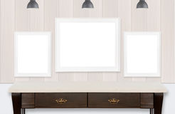 Frames on wood wall and white background Stock Images