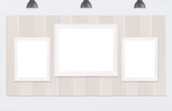 Frames on wood wall and white background. Three picture frames on wood wall and white background stock images