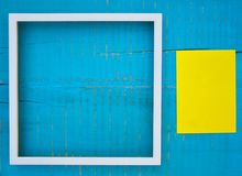 Frames on wooden background. White frames and paper cards on blue wooden background Stock Photo