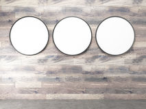 Frames on wooden wall Royalty Free Stock Photos