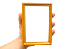 Framework. Wooden framework in a hand on a white background royalty free stock photo