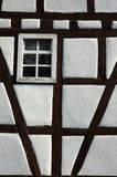 Framework. Detail of a timber-framed house with a window Stock Photography