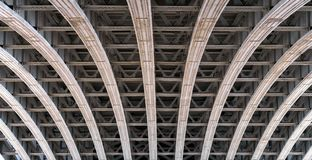 Framework arch under a bridge over the river Thames in London royalty free stock photo