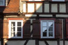 Framework facade with window shutters. On a sunny summer morning in south germany city schwaebeisch gmuend stock photos