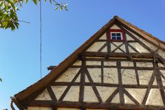 Framework facade with window shutters. On a sunny summer morning in south germany city schwaebeisch gmuend stock image