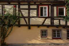 Framework facade with window shutters. On a sunny summer morning in south germany city schwaebeisch gmuend stock photography