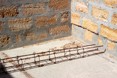 Framework from fittings on building. Internal corner of the house under construction. On a concrete coupler - a framework from fittings and a wire. Horizontally Royalty Free Stock Image