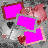 Framework with hearts and albums. Framework with hearts and photograph albums on a grey background with signatures Royalty Free Stock Image
