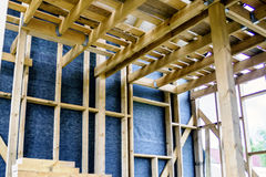 Framework of the house wall, of boards and timber, a window, a vapor barrier Stock Photography