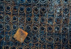 Framework of old and abandoned mattress. Corroded and rusty metal spring. Abstract pattern stock image