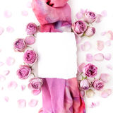Framework from roses and silk on white background. Flat lay. Top view Stock Photo