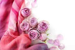 Framework from roses and silk on white background. Flat lay. Top view Royalty Free Stock Images