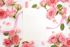 Framework from roses on white background. Flat lay, top view Stock Photos