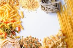 Framework of uncooked pasta isolated Stock Photo