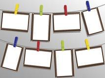 Frameworks. Photo frameworks fixed by pins on clothesline Stock Photo