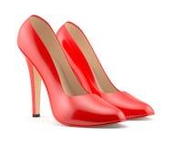 Framför av en röd sko för höga häl på vit bakgrund isolerat Arkivbilder