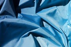 framför blått tyg för bakgrund 3d Arkivfoton