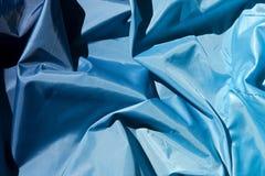 framför blått tyg för bakgrund 3d Arkivfoto