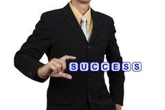 Framgång för affärsmanshoword arkivfoto