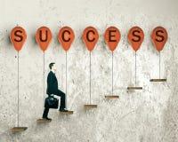 Framgångbegrepp med affärsmannen Arkivbild