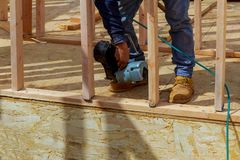 Framing building contractor framing up wall section for a luxury custom house. Framing building contractor framing authentic construction worker wall section for royalty free stock photo
