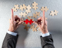 Framing Businessman Hands Picking The Odd One To Link Others Stock Images