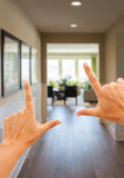 Framing Hands Looking Down Hallway of House. Female Framing Hands Looking Down The Hallway of New House royalty free stock photos