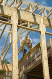 Framing a house 1. Construction worker framing the roof of a country house stock images