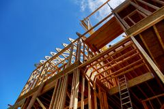 Framing of house Closeup new stick built home under construction under blue sky construction and real estate. Framing of a house closeup new stick built home royalty free stock photography