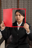 Framing with magazine (room ba. A young businesswoman holding a magazine (look like she reads it) where her face is on cover page Stock Photo