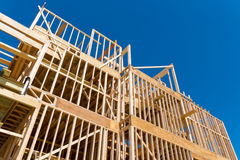 Framing of new home construction. Against blue sky Stock Photo