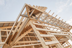 Framing new wooden building structure construction. Details of the framing of a new wood framed building under construction Royalty Free Stock Photography