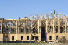 Framing project. New building under construction, carpenters installing frame work Stock Photo