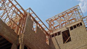 Framing structure wood frame of wooden houses home close-up new stick built home under construction under stock video