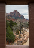 Framing the Watchman. From a window on a bridge Royalty Free Stock Photo