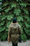 Framme av julgranen arkivfoto